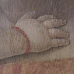 Particolare della mano del Bambino prima del restauro
